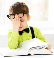Little boy is reading a book photo