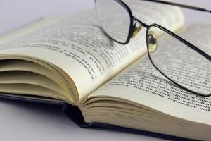 Glasses on the book photo