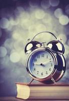 Alarm clock and book photo