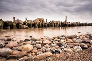 Groynes on shore of the Baltic Sea photo