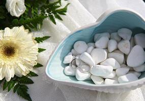 Wedding rings on sea pebbles photo