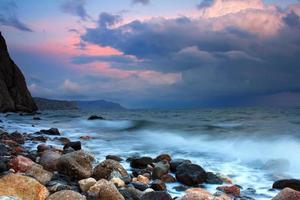 Storm at sea at sunset