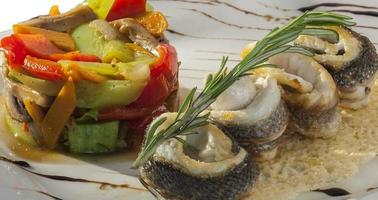 rolls of sea bass with vegetables