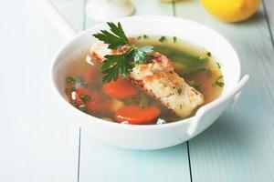 Sea food soup with cod fish steak