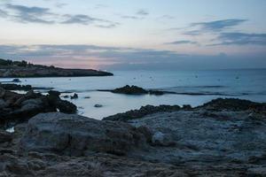 Rocks at the blurred sea watter, long exposure photo