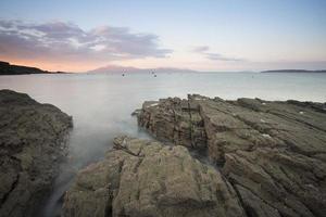 sea on the shore of scotland  at sunrise photo