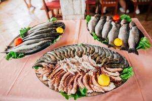 fresh seafood, fish, shrimps,squids, octopuses, sea bass photo