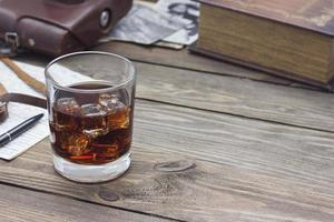 whiskey with old books photo
