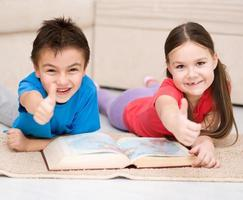 Children is reading book photo