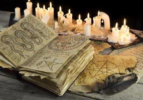 Grimoire book with candles photo