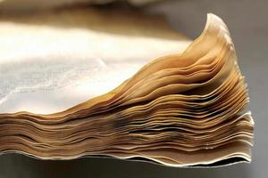 Closeup of an old rusty open book photo