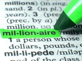Millionaire Highlighted In Dictionary With Green photo
