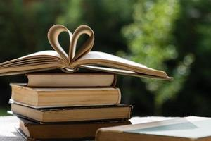 stack of books with heart shape