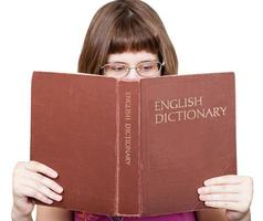 girl with spectacles reads English Dictionary book photo
