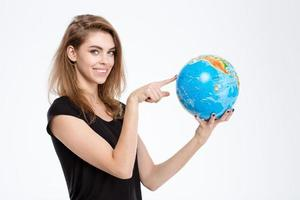 Woman pointing finger on world globe