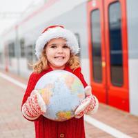 Little girl Santa traveling