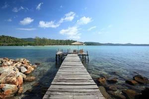 Wooden bridge into the sea photo