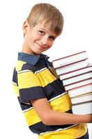 School boy is holding books