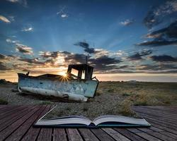 Abandoned fishing boat on beach landscape at sunset conceptual b
