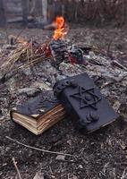 Magic books on the ashes, Halloween theme photo