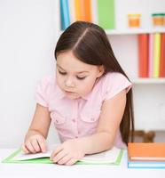 Little girl is reading a book photo