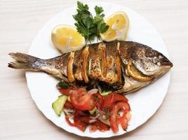 Cooked fish sea bream fish with.