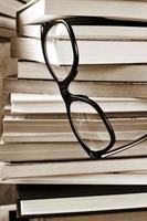 books and eyeglasses, in black and white