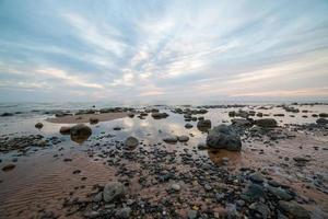 rocky sea beach with wide angle perspective photo