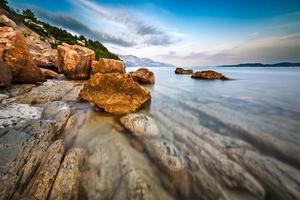 Rocky Beach and Transparent Adriatic Sea near Omis photo