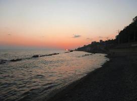 Sunset over summer sea with a small waves photo