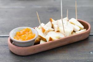 Spiced cheeseboard with sea buckthorns jam in crockery