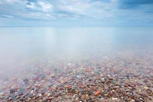 Beautiful long exposure landscape of rocky sea shore. photo