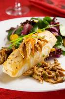 Sea bass with mushrooms and salad