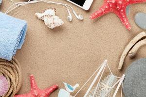 Travel and vacation items on sea sand
