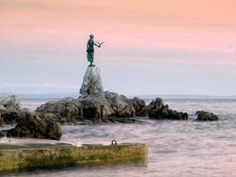 View of Opatija statue from the beach  photo