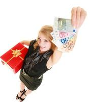 Woman with gift box and euro currency money banknotes. photo