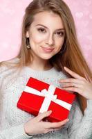 Joyful girl gift box pink background, Valentines Day, Women's Day photo
