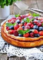 Cottage cheese casserole with fresh strawberries, blueberries, raspberries and mint photo