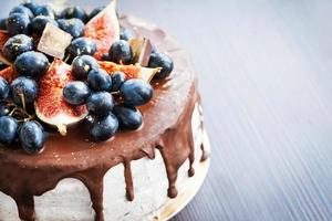 Chocolate icing cake, decorated with fresh fruit