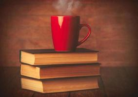 Cup of coffee and books photo