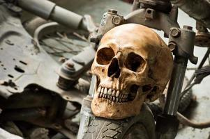 skull with old motorcycle photo