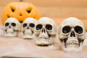 Halloween pumpkin and skulls photo