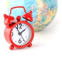 Red alarm clock and globe world time