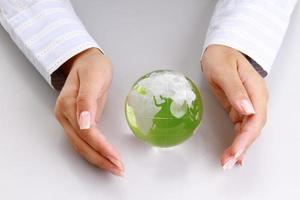attractive woman holding a glass globe