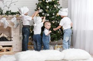 Children decorate a Christmas tree toys photo