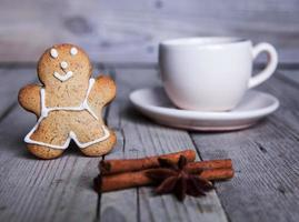 Christmas homemade gingerbread man on wooden background.