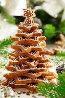 Tree of ginger cookies on a festive table. photo