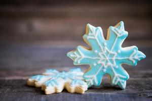 Snowflake cookies on wooden background