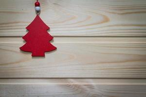 Christmas wooden background decorated with a toy.