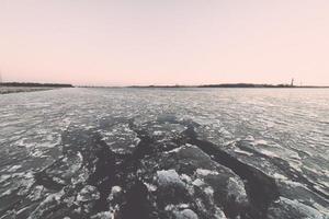 sunset over frozen sea - vintage retro effect